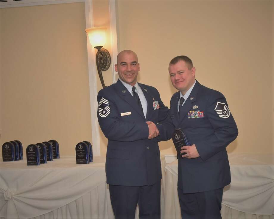 Chief Master Sgt. Joshua Walters, 109th Security Forces Squadron manager, presents the Wing Staff Noncommissioned Officer of the Year Award to Master Sgt. Jeremiah P. Henderson. (109th Airlift Wing)