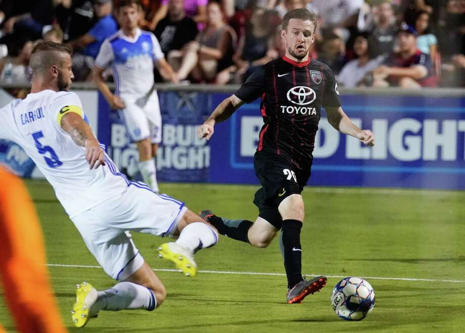 San Antonio FC's Greg Cochrane (right) chases after a ball as Reno 1868 FC defender Zach Carroll closes in during Saturday's United Soccer League match at Toyota Field. Reno won 2-0. Photo: Darren Abate /Darren Abate /USL / Darren Abate Media LLC