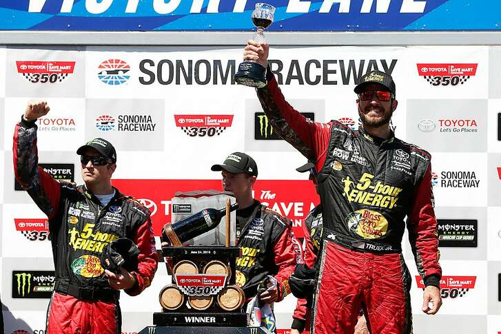 SONOMA, CA - JUNE 24:  Martin Truex Jr., driver of the #78 5-hour ENERGY/Bass Pro Shops Toyota, celebrates in victory lane by drinking wine after winning the Monster Energy NASCAR Cup Series Toyota/Save Mart 350 at Sonoma Raceway on June 24, 2018 in Sonoma, California.  (Photo by Brian Lawdermilk/Getty Images)