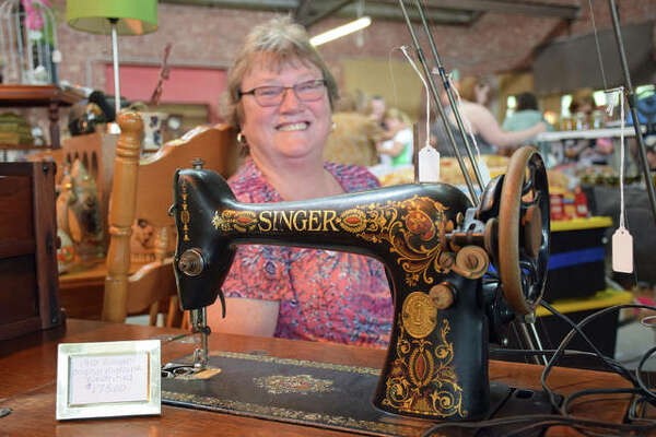 Janet Presley and a 1910 Singer sewing machine.