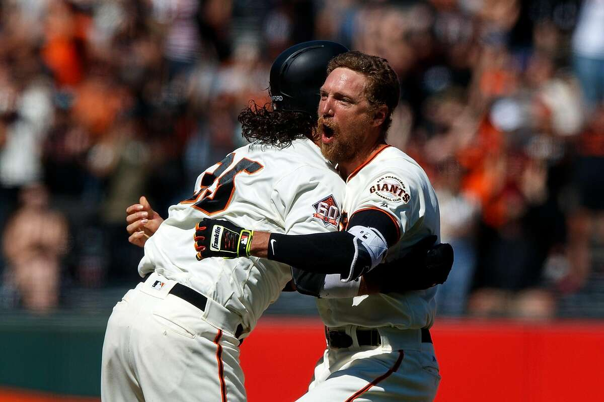 SAN FRANCISCO, CA - JUNE 24: Hunter Pence #8 of the San Francisco Giants is congratulated by Brandon Crawford #35 after hitting a two run walk off double against the San Diego Padres during the eleventh inning at AT&T Park on June 24, 2018 in San Francisco, California. The San Francisco Giants defeated the San Diego Padres 3-2 in 11 innings. (Photo by Jason O. Watson/Getty Images)