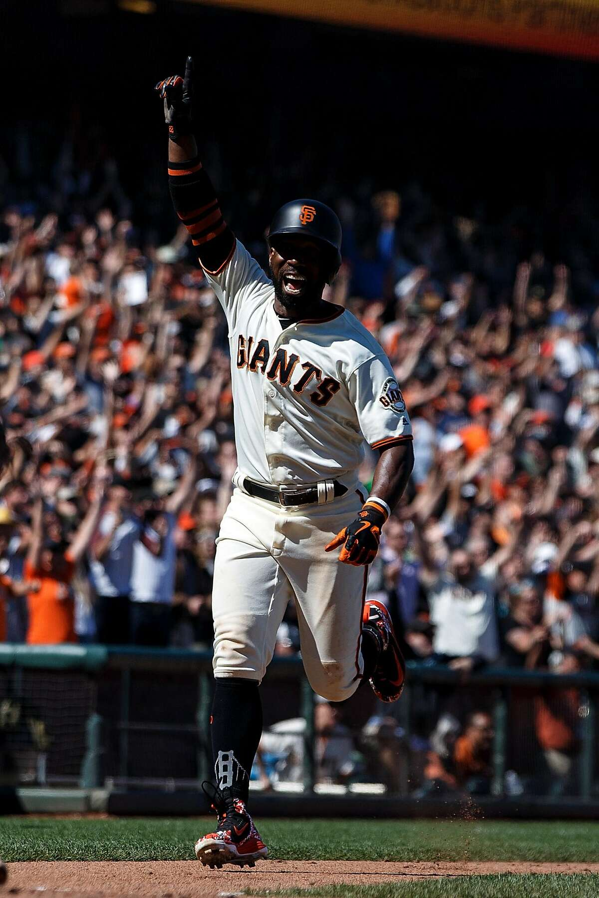 SAN FRANCISCO, CA - JUNE 24: Andrew McCutchen #22 of the San Francisco Giants celebrates while scoring on a two run walk off double by Hunter Pence (not pictured) against the San Diego Padres during the eleventh inning at AT&T Park on June 24, 2018 in San Francisco, California. The San Francisco Giants defeated the San Diego Padres 3-2 in 11 innings. (Photo by Jason O. Watson/Getty Images)