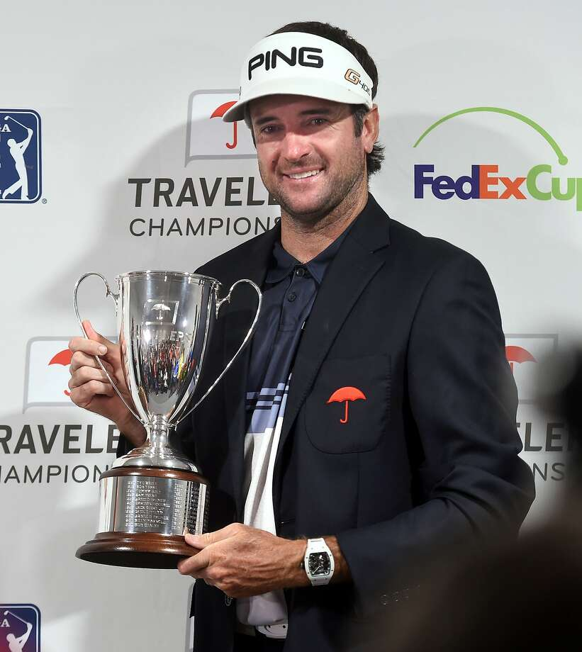 Bubba Watson holds the trophy after winning the Travelers Championship in Cromwell on June 24, 2018. Photo: Arnold Gold, Hearst Connecticut Media