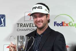 Bubba Watson holds the championship trophy after winning the Travelers Championship on Sunday in Cromwell.
