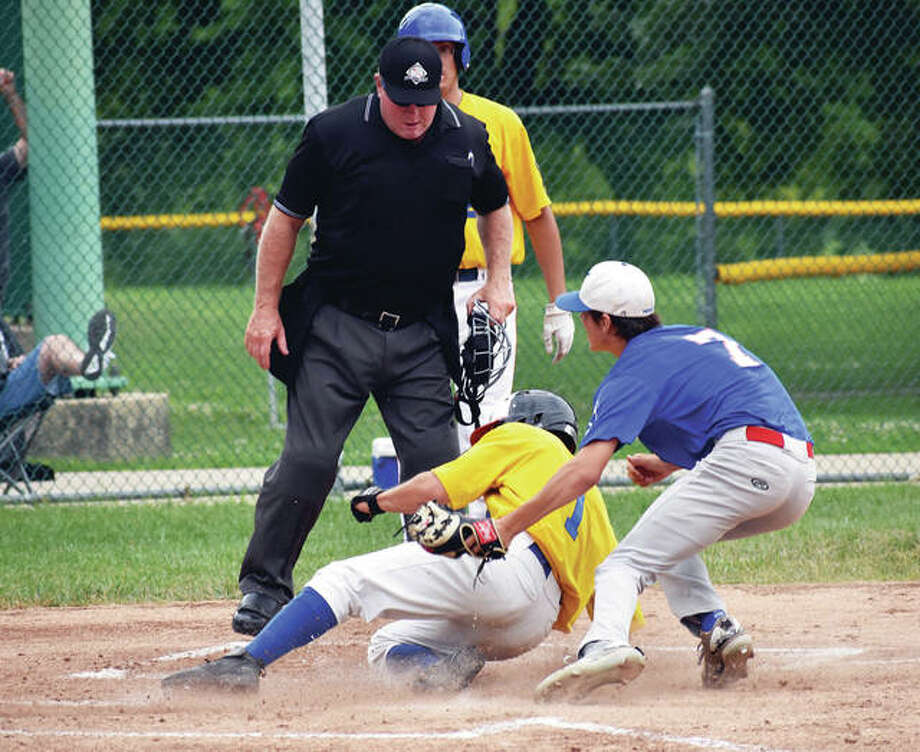 Post 199's Tate Wargo is safe at home in Sunday's American Legion baseball game against the New Athens 76ers Sunday at Hope Park. Photo:     Matthew Kamp | For The Telegraph