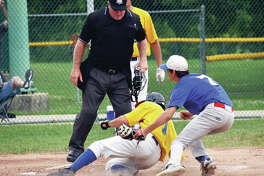 Post 199's Tate Wargo is safe at home in Sunday's American Legion baseball game against the New Athens 76ers Sunday at Hope Park.