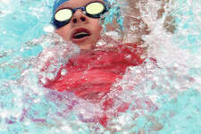 Anna Moehn of the TCAY Tidalwaves swims the backstroke portion of the girls 13-14 individual medley final at the 80th Clayton Shaw Park Tideriders Summer Invitational Sunday in Clayton, Mo.
