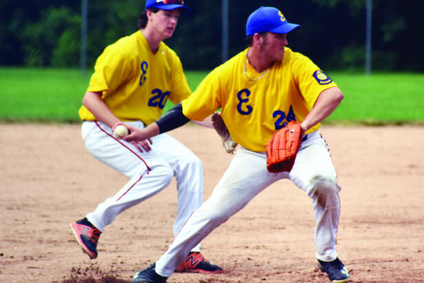 Edwardsville Post 199 Bears second baseman Reid Hendrickson, right, throws out a runner at first base during the third inning of Sunday's game against New Athens at Hoppe Park.