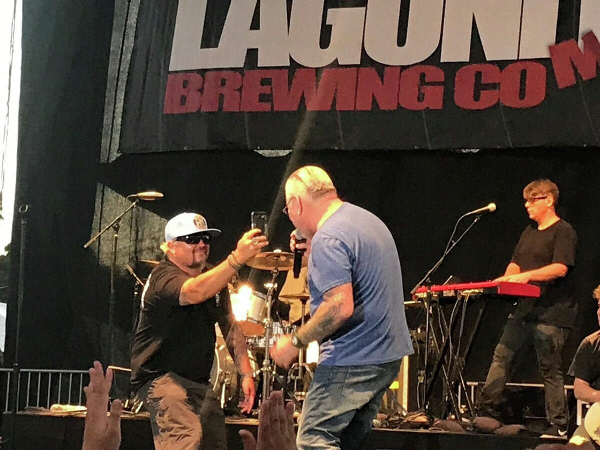 Guy Fieri is seen onstage with band Smash Mouth in Petaluma, Calif. on Saturday, June 23, 2018.