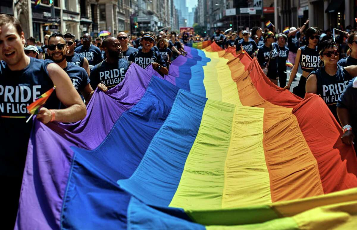 Reveler carry a LTBGQ flag along Fifth Avenue during the New York City Pride Parade on Sunday, June 24, 2018, in New York. (AP Photo/Andres Kudacki)
