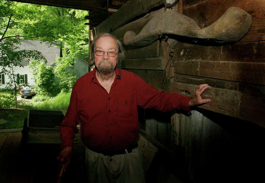 FILE - In this June 13, 2006, file photo, Donald Hall, author of numerous poetry books, poses in the barn of the 200-year-old Wilmot farm that has been in his family for four generations. Hall, a prolific, award-winning poet and man of letters widely admired for his sharp humor and painful candor about nature, mortality, baseball and the distant past, died at age 89. Hall's daughter, Philippa Smith, confirmed Sunday, June 24, 2018, that her father died Saturday at his home in Wilmot, after being in hospice care for some time. (AP Photo/Jim Cole, File) Photo: JIM COLE / AP2006