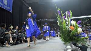 Albany High School graduates walk across the stage to receive their diplomas during their graduation at the Times Union Center on Sunday, June 24, 2018, in Albany, N.Y.  (Paul Buckowski/Times Union)