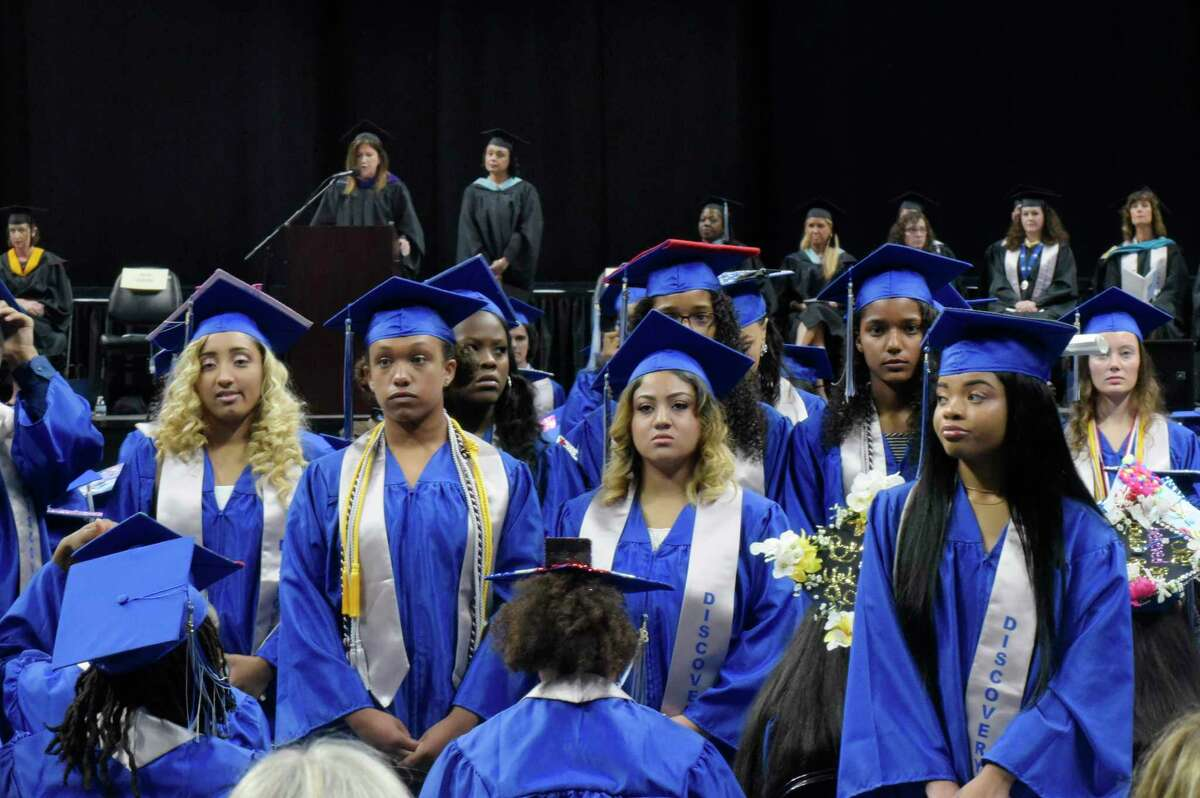 A number of Albany High School graduates stand and turn their back on Sue Adler, background left, the president of the Board of Education, as she gave a speech at the Albany High School graduation at the Times Union Center on Sunday, June 24, 2018, in Albany, N.Y. (Paul Buckowski/Times Union)