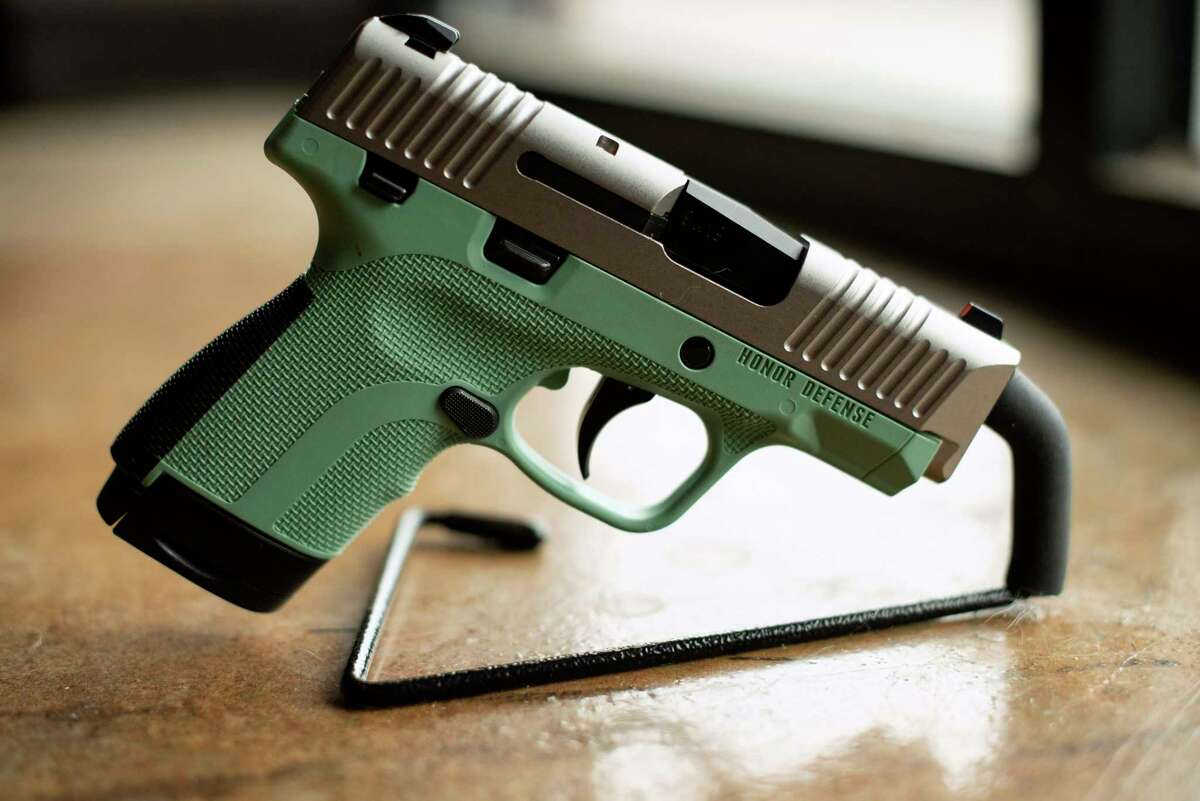 In this April 25, 2018 photo, a .9mm handgun produced by Honor Defense, a gunmaker in Gainesville, Ga., is displayed. In the wake of high-profile mass shootings, corporate America has been taking a stand against the firearms industry amid a lack of action by lawmakers on gun control. Payment processing firms are limiting transactions, Bank of America stopped providing financing to companies that make AR-style guns, and retailers like Walmart and Dick?'s Sporting Goods imposed age restrictions on gun purchases. (AP Photo/Lisa Marie Pane)