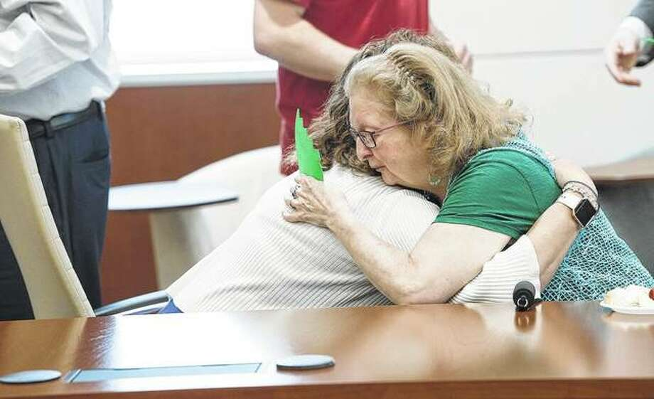 Deborah Kunath (right) of Jacksonville hugs Misty Shaw of Springfield, a non-directed, altruistic donor who gave her kidney to Deborah. The two met each other for the first time Wednesday. Photo:       Bobbi Wiseman | Memorial Health System