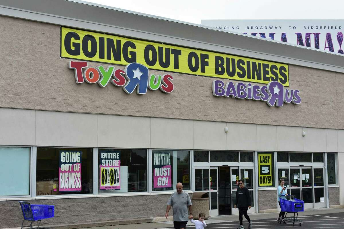Shoppers leave Toys R Us on Connecticut Avenue in Norwalk on Sunday as the iconic toy retailer's U.S. stores enter the final week of business.