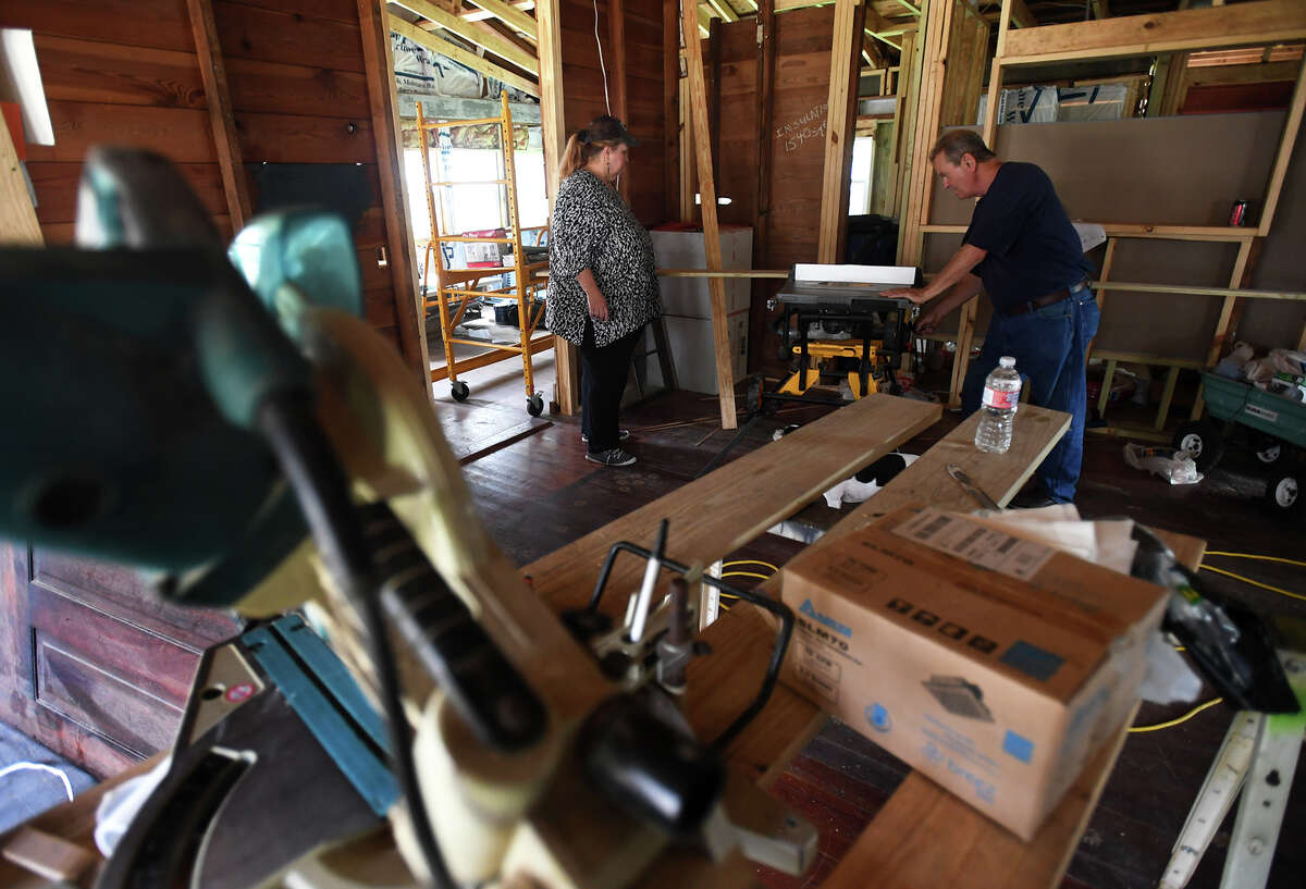 Susan Kilcrease and Dennis Kilcrease cut timber during the remodel process of their 1920's Silsbee home. Photo taken Friday, 6/22/18