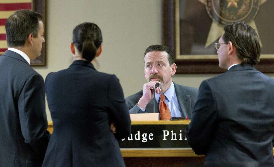 Judge Phil Grant, center, listens to Montgomery County Assistant District Attorney Kelly Blackburn, (far left) and attorney for Sophia Perez Heath, (far right) in 9th state District court at the Lee G. Alworth Building, Thursday, Feb. 1, 2018, in Conroe. Photo: Jason Fochtman, Staff Photographer / Houston Chronicle / © 2018 Houston Chronicle