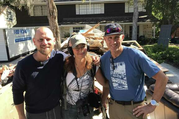 """Pastor Aric Brian Harding with Producer/Director/Camera Liesl Clark and her husband, Sound Recordist, Pete Athans, outside Aric's home in Friendswood, Texas. They came together for Clark's documentary, """"Rise of the Superstorms."""""""
