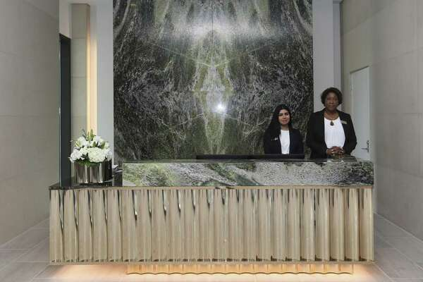 The River Oaks luxury high rise's reception desk is photographed after the completion of the near-four-year remodling of the 1960s building on Wednesday, June 20, 2018, in Houston.  ( Yi-Chin Lee / Houston Chronicle )