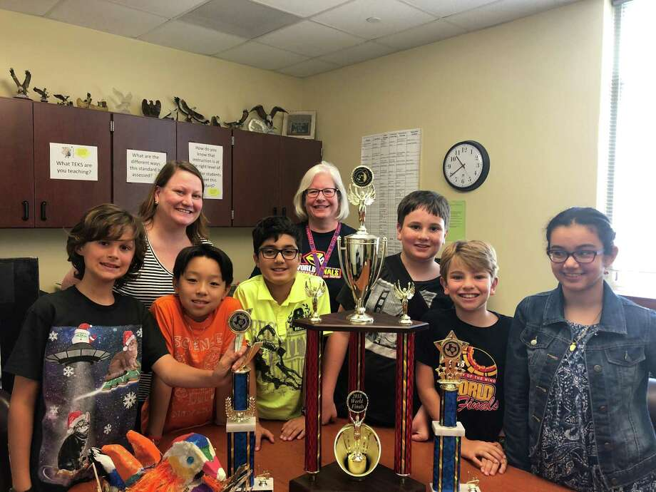 The team from Walnut Bend Elementary School won second place in the Odyssey of the Mind World Finals May 23-26 in at Iowa State University. From left to right: Elliot Arntz, WBES registrar and Odyssey Coach Penny Blair, Hans Winata, Ammar Guliyev, WBES Principal and Odyssey Coach Michele Dahlquist, Andrew Blair, Brody Niece and Fatema Al Jawahery. Not pictured: Diamon Green. Photo: Tracy Maness
