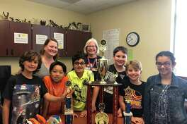 The team from Walnut Bend Elementary School won second place in the Odyssey of the Mind World Finals May 23-26 in at Iowa State University. From left to right: Elliot Arntz, WBES registrar and Odyssey Coach Penny Blair, Hans Winata, Ammar Guliyev, WBES Principal and Odyssey Coach Michele Dahlquist, Andrew Blair, Brody Niece and Fatema Al Jawahery. Not pictured: Diamon Green.