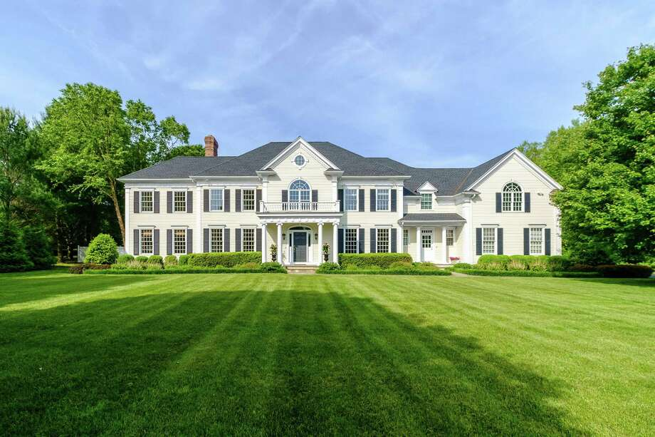 The colonial house at 371 Midlock Road was built in 1998, one of eight houses in the Audubon Farm subdivision, which won a HOBI Award for the builder. Photo: Nathan Spotts And/or Lauren Kinkade / © Nathan Spotts & Lauren Kinkade