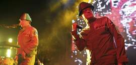 Gerald Casale (left) and Mark Mothersbaugh of Devo perform in Los Angeles in 2011. The group headlines Burger Boogaloo this weekend.