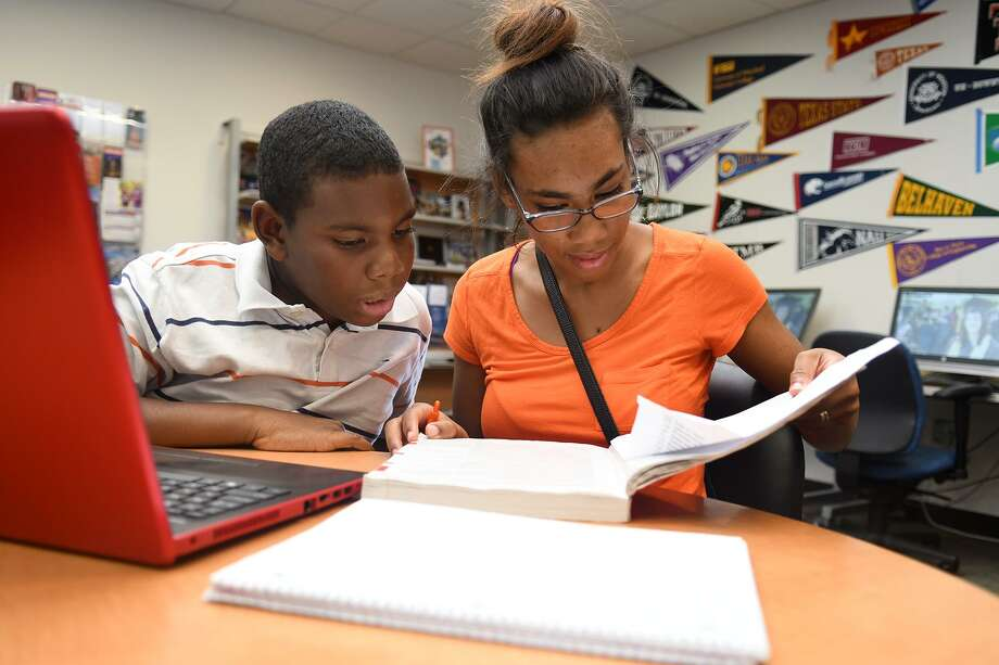 Nehemiah Juniel, 11, left, and his sister Gabrielle, 15, study together in the Center for Academic Student Affairs at Lone Star College - CyFair after their classes at the school on June14, 2018. (Jerry Baker/For the Chronicle) Photo: Jerry Baker, Freelance / For The Chronicle / Freelance