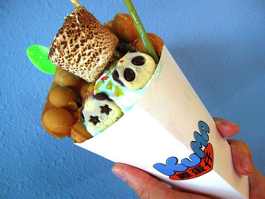 Hong Kong-style bubble waffle ice cream cone with unicorn ice cream, Fruity Pebbles, a toasted marshmallow and more from Kuma on Babcock Road in San Antonio. Photo: Mike Sutter /Staff File Photo