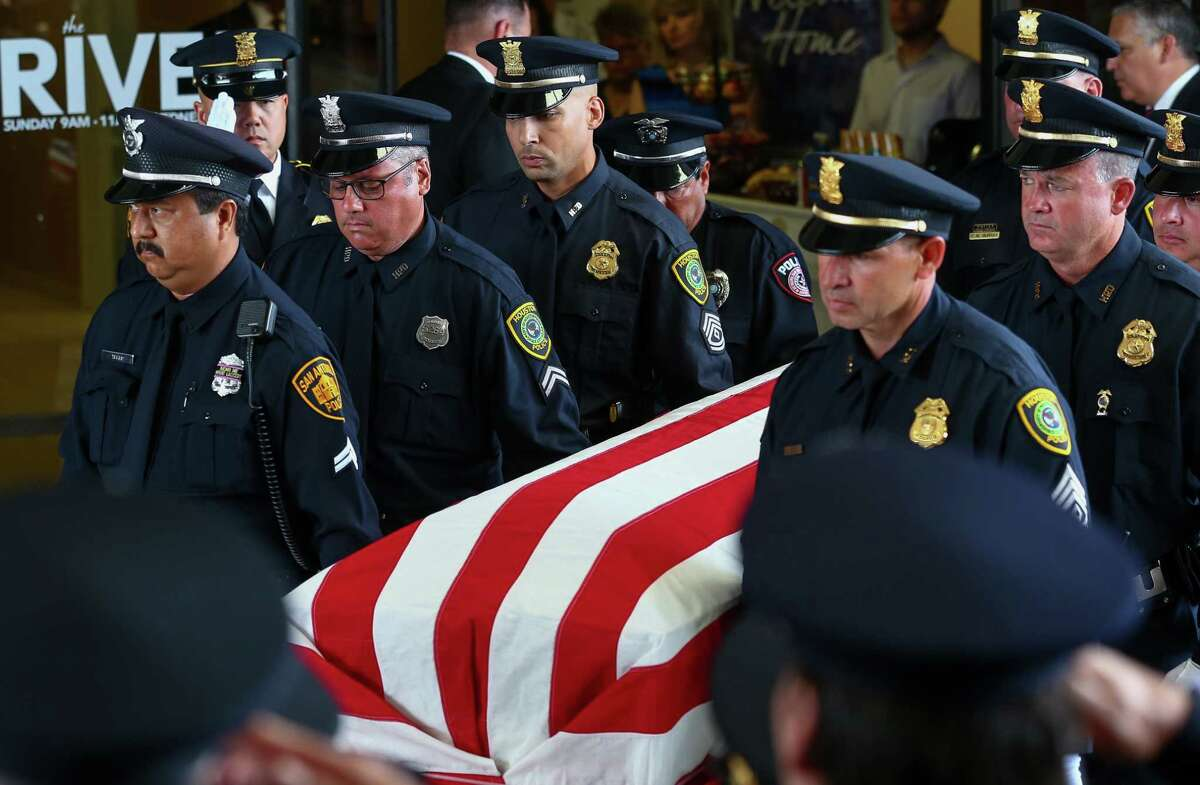 Pallbearers carry Houston Police senior officer Norbert Ramon's coffin after the celebration of life ceremony at River Pointe Church Monday, June 25, 2018, in Channelview, Texas. Officer Ramon, 56, was a 25-year HPD veteran who lost his battle to cancer June 15. In the midst of his treatments Ramon rescued victims during Hurricane Harvey last year.