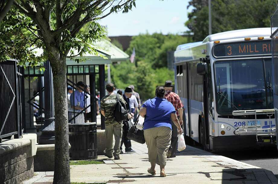 Passengers board buses at the HARTransit hub on Kennedy Avenue in Danbury on Monday. Danbury received $2 million in grants from the state to support its plan to revitalize the downtown area around the train and bus stations. Photo: Carol Kaliff / Hearst Connecticut Media / The News-Times