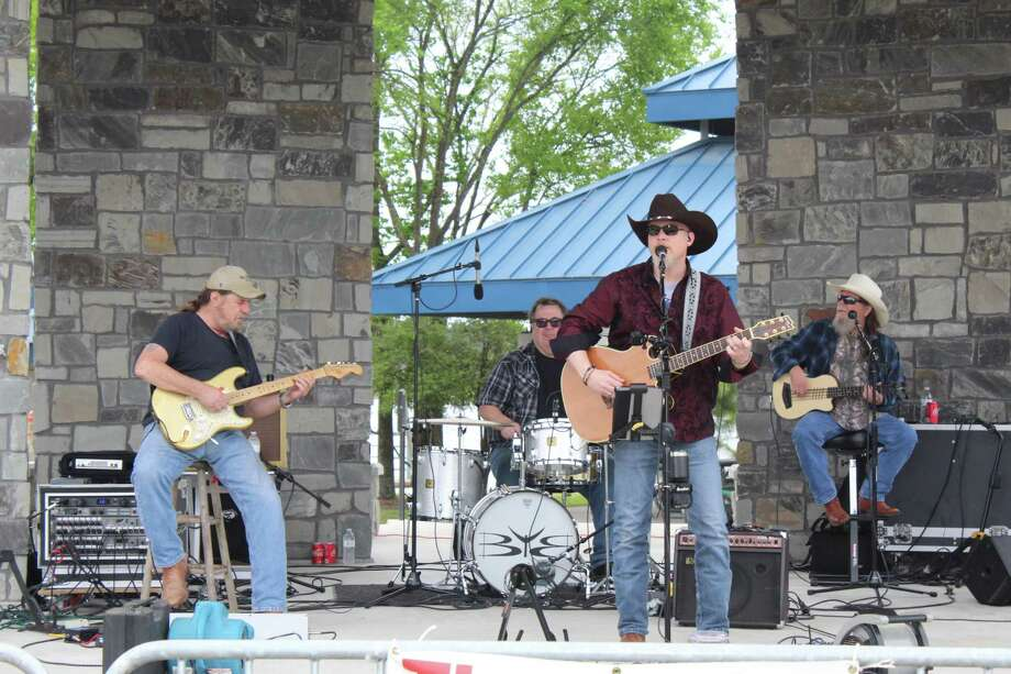The Buck Yeager Band will perform during the New Year's Eve celebration and dance at 8 p.m. at the Tomball VFW Post 2427. Advance tickets start at $35 and can be purchased online. The band has been performing locally and across the state for more than 16 years. The Tomball VFW Post 2427 is located at 14408 Alice Road in Tomball. Learn more at www.vfwpost2427.org or call 281-351-2427. Above, The Buck Yeager Band entertained during the Northshore Park celebration that followed the annual GreenUp event hosted by The Woodlands Township. Photo: Staff Photo By Patricia Dillon / Staff Photo By Patricia Dillon