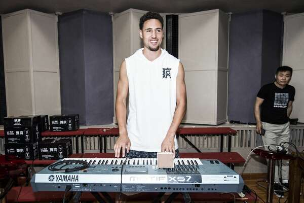 NBA player Klay Thompson of the Golden State Warriors play electronic piano with a band on June 24, 2018 in Beijing, China. (Photo by DI YIN/Getty Images)