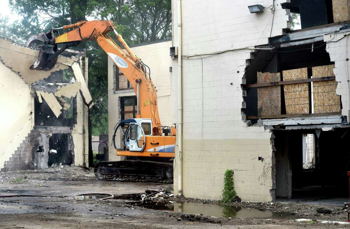 Demolition begins at the Church Street South housing complex in New Haven on June 25, 2018.