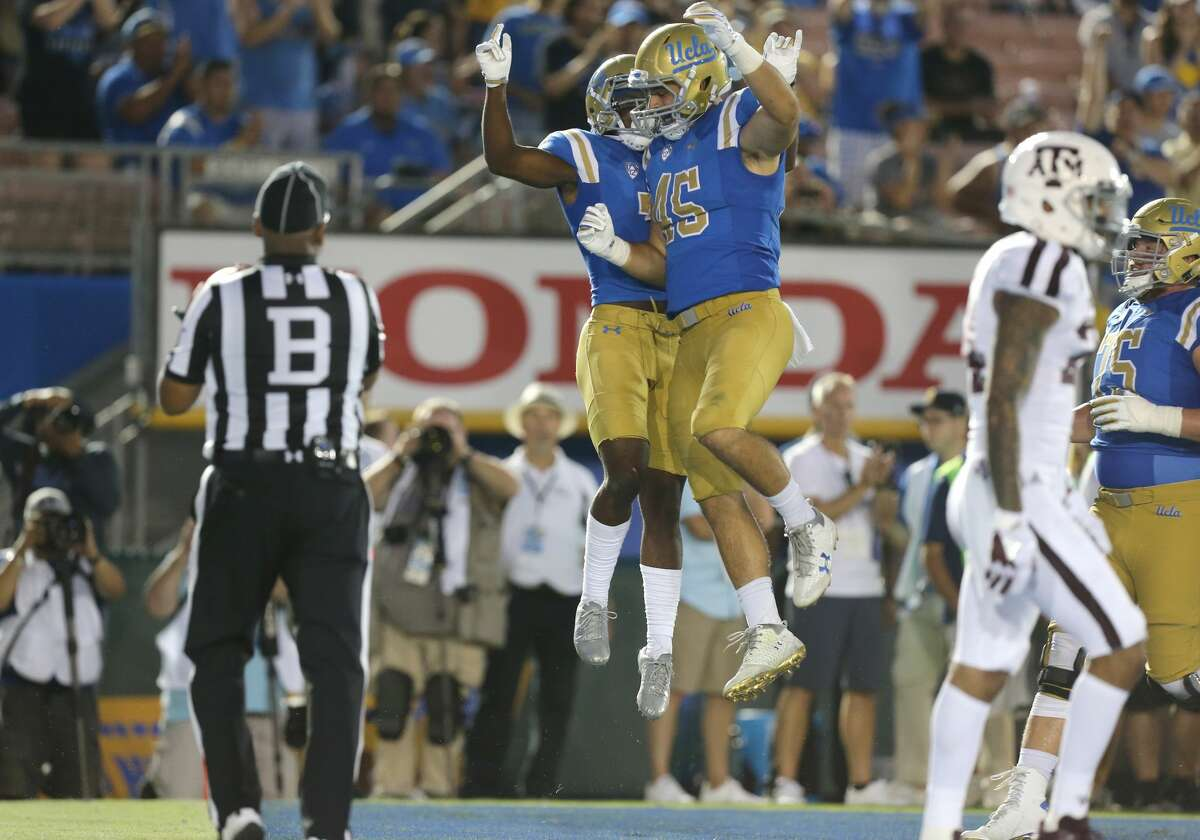 PASADENA, CA - SEPTEMBER 03: UCLA Bruins (7) Darren Andrews (WR) celebrates with UCLA Bruins (45) Giovanni Gentosi (RB) after Andrews scores a touchdown during the game against the Texas A & M Aggies on September 03, 2017, at the Rose Bowl in Pasadena, CA. (Photo by Adam Davis/Icon Sportswire via Getty Images)