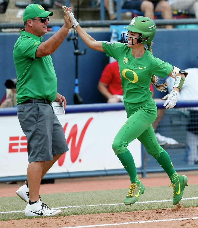 Oregon's Haley Cruse (26) high-fives coach Mike White after hitting a two-run home run against Arizona State in the bottom of the fifth inning during the first game of the NCAA softball Women's College World Series, in Oklahoma City, Thursday, May 31, 2018. (Nate Billings/The Oklahoman via AP) Photo: NATE BILLINGS, Associated Press / NATE BILLINGS/THE OKLAHOMAN