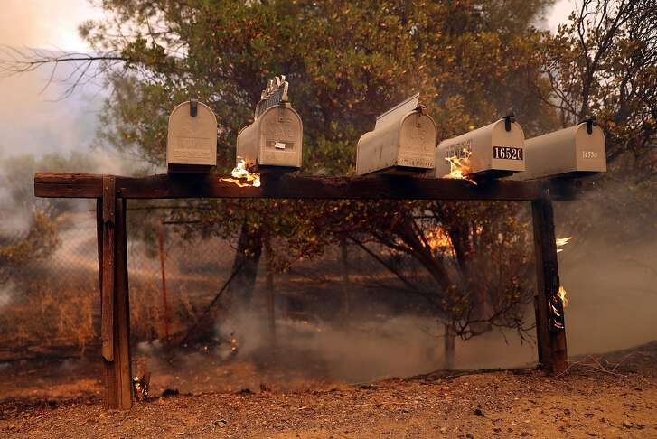 Mailboxes burn along Spring valley Road as Cal Fire battles the Pawnee Fire in Lake County, Calif. on Sunday, June 24, 2018.