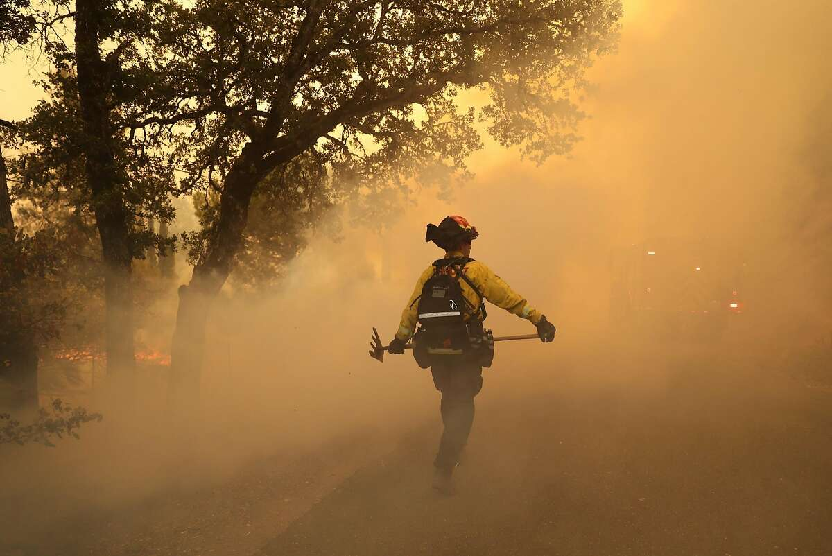 Cal Fire battles the Pawnee Fire along Spring Valley Road in Lake County on June 24, 2018.