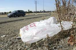 A plastic grocery bag litters a roadside. At least a dozen Texas cities have decided to either regulate or ban bags like this one, but the state Supreme Court recently ruled that municipalities don't have that power.