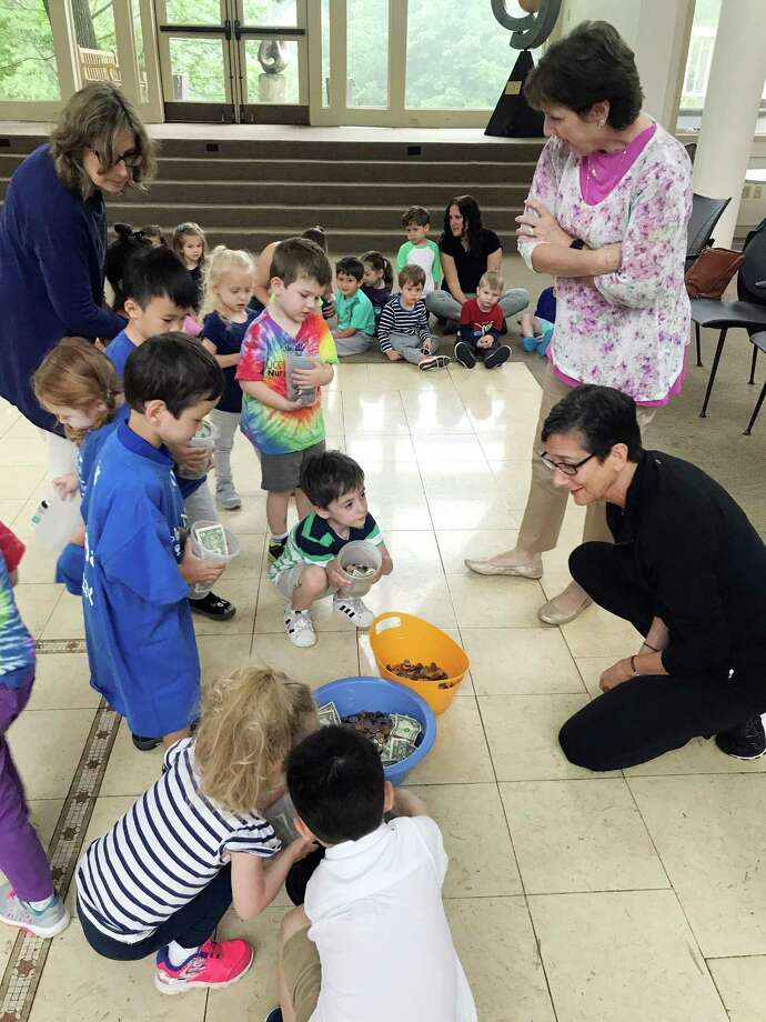 "Students at the Stamford Jewish Community Center's Sara Walker Nursery School in Stamford, Conn. participate in ""tzedakah"" where they bring in coins each week to donate to a community organization to teach them the spirit of giving. Photo: Contributed Photo / Contributed Photo / Stamford Advocate contributed"