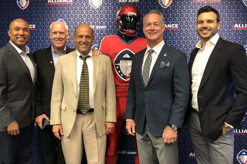 "San Antonio will be home to a new professional football team as a part of the newly-formed Alliance of American Football. The team will be coached by former Oregon State coach Mike Riley, third from left, and the general manager will be former Cowboys fullback Daryl ""Moose"" Johnston, second from right."