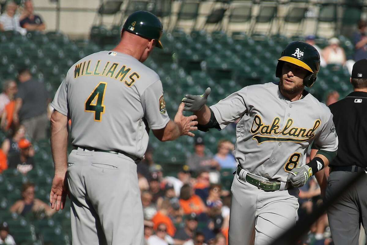 DETROIT, MI - JUNE 25: Jed Lowrie #8 of the Oakland Athletics celebrates his ninth inning home run with third base coach Matt Williams while playing the Detroit Tigers at Comerica Park on June 25, 2018 in Detroit, Michigan. (Photo by Gregory Shamus/Getty Images)