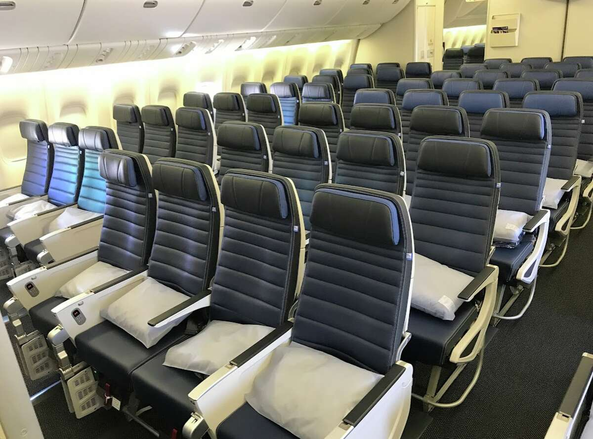 United Airlines' economy class seats on a Boeing 777-200ER are 10-across, configured 3-4-3. Note economy plus with darker headrests