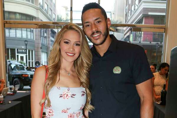 """Houston Astros player Carlos Correa and fiancée Miss Texas USA 2016 Daniella Rodriguez pose for a photograph at """"Team Up for Kids and K9s"""" benefitting various charitable causes that hosts Astros players Lance McCullers Jr., Dallas Keuchel and Jose Altuve are passionate about on Thursday, May 17, 2018, in Houston. Benefitting organizations included animal rescue efforts, children's charities, and other initiatives throughut the Greater Houston community."""