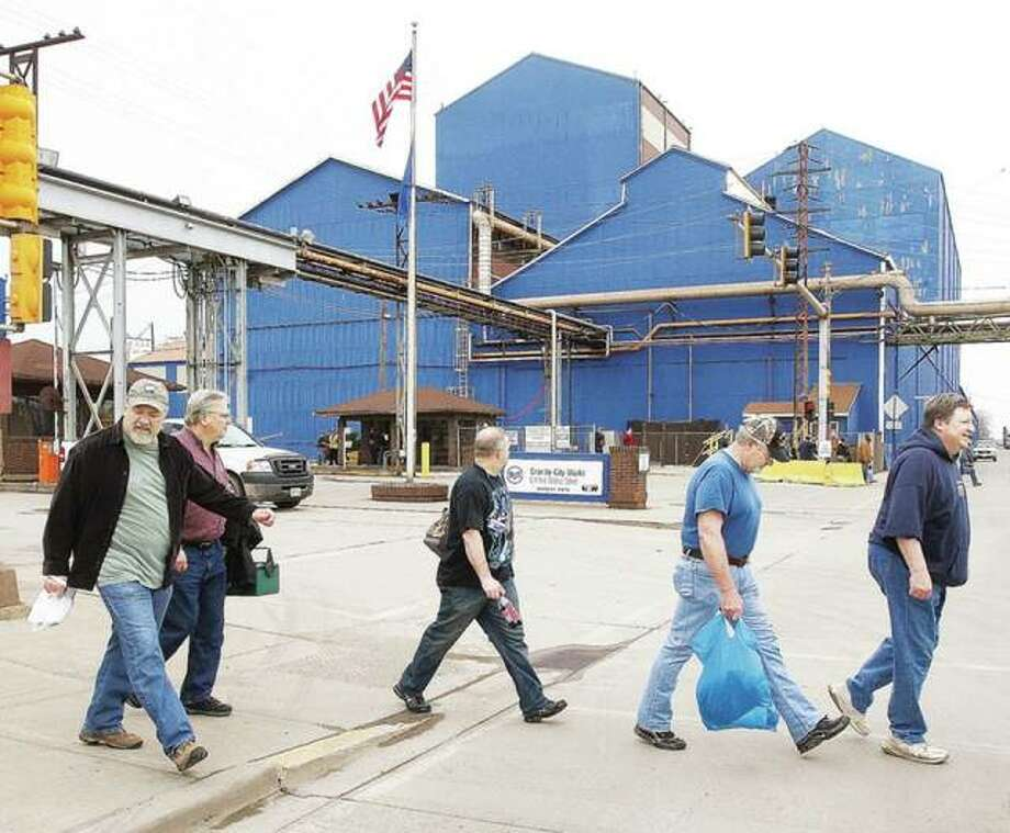 In this March 2015 file photo, workers leave the Nash Street gate of United States Steel's Granite City Works.