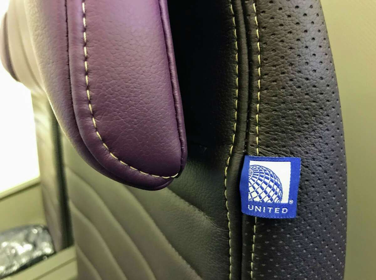 United Airlines' new Premium Plus seat on a Boeing 777-200ER- note the perforated leather, white stitching and designer label