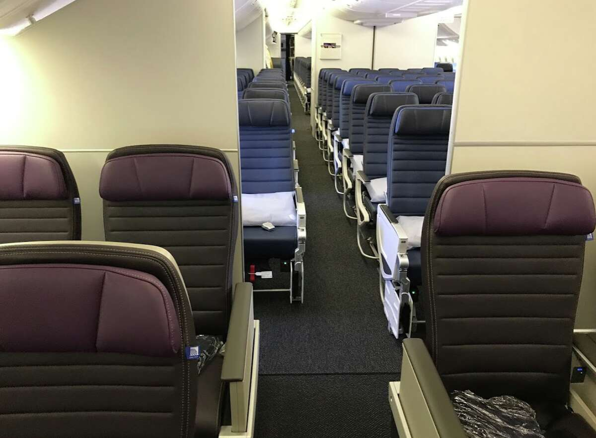 United Airlines' new Premium Plus seat on a Boeing 777-200ER- the cabin has privacy walls front and rear