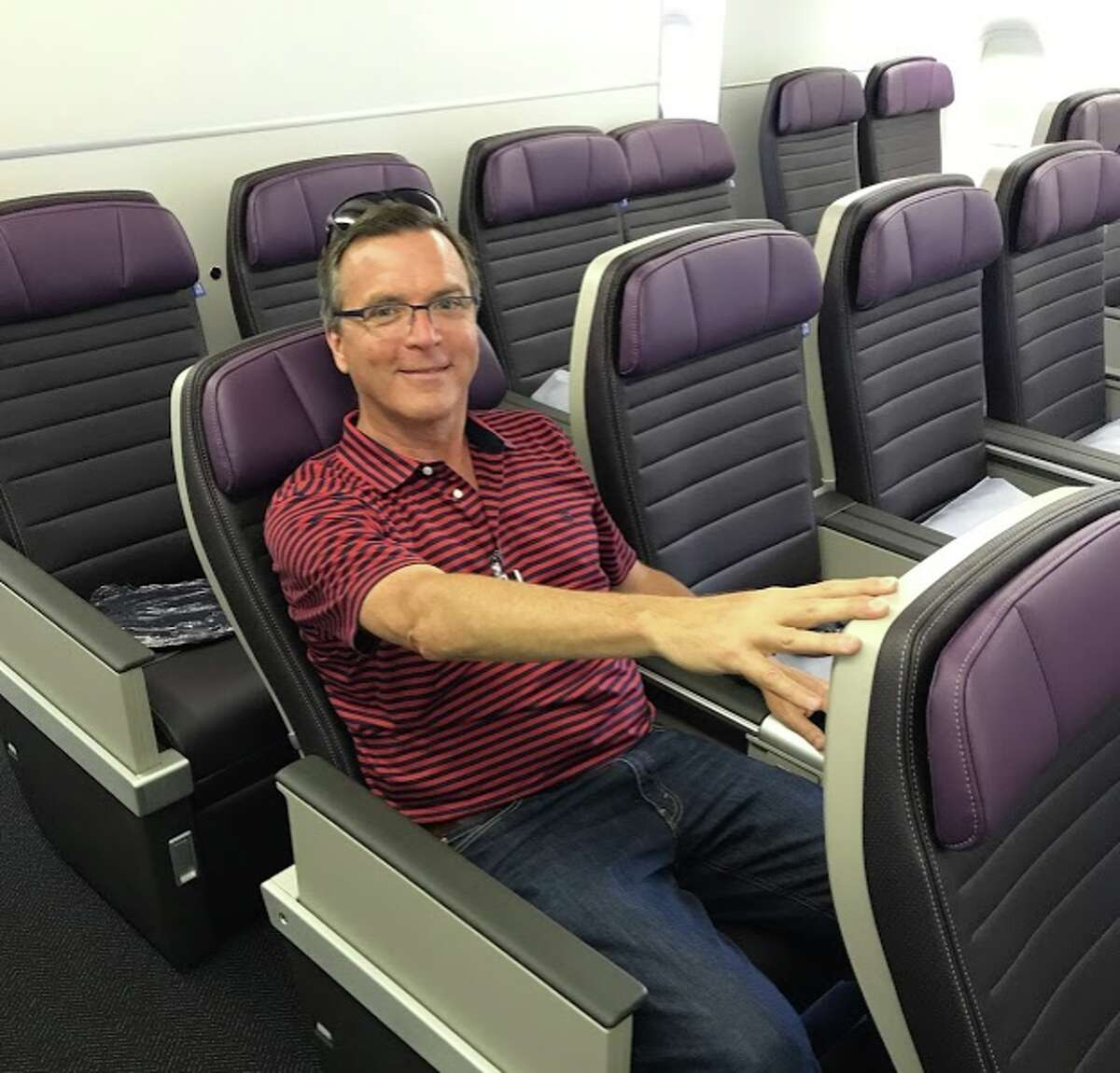 United Airlines' new Premium Plus seat on a Boeing 777-200ER- fits my 6 foot frame just fine.