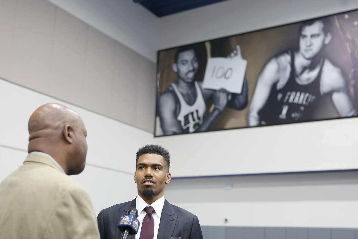 Golden State Warriors NBA basketball draft pick Jacob Evans speaks to a reporter after a news conference announcing his NBA draft pick at the Rakuten Performance Center on Monday, June 25, 2018 in Oakland, Calif.